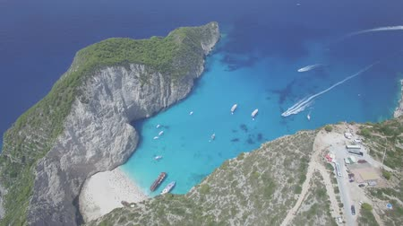 navagio : 4k Aerial view of Navagio beach Shipwreck view in Zakynthos (Zante) island, in Greece - Log Stock Footage