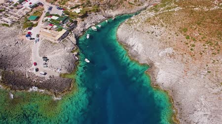 atracação : 4K Aerial view of Porto limnionas beach in Zakynthos (Zante) island, in Greece