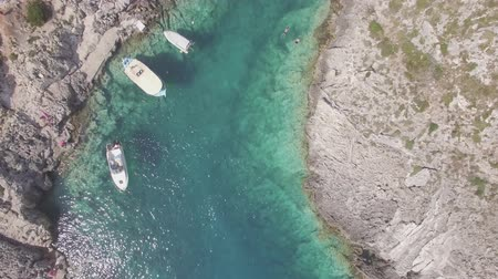 mooring : 4K ungraded Aerial view of Porto limnionas beach in Zakynthos (Zante) island, in Greece - Log
