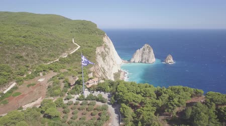 zante : 4K ungraded aerial view of Greek national flag waving in the sky in Keri in Zakynthos (Zakynthos) island in Greece - Log