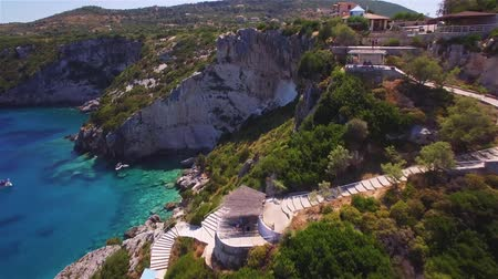 zante : 4K (UHD) Aerial view of Agios Nikolaos blue caves in Zakynthos (Zante) island, in Greece Stock Footage