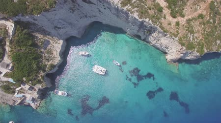mooring : 4K (UHD) Aerial view of Agios Nikolaos blue caves in Zakynthos (Zante) island, in Greece - Log