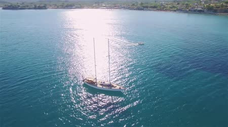 zante : 4K (UHD) Aerial view of a boat mooring in Laganas Bay in Zakynthos (Zante) island, in Greece