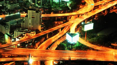 экономический : Expressway in the city. Night time lapse Bangkok Thailand