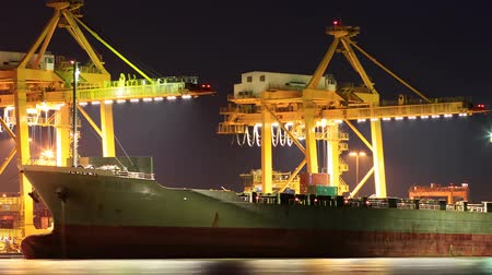 industry : Container Cargo freight ship with working crane bridge in shipyard at dusk for Logistic Import Export background