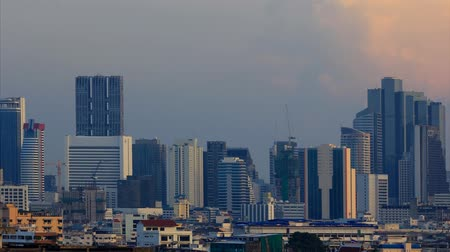 capital cities : Bangkok is a city with tall buildings and homes.