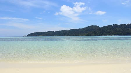 beach panorama : Coast of the island with white sand, blue water in summer. Stock Footage