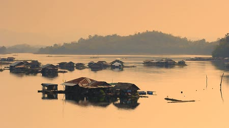 subsistence : Rural house rafts in the evening. Stock Footage