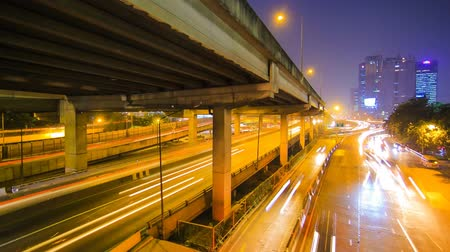 night scene : Traffic in the city. There are several freeway lane. Stock Footage