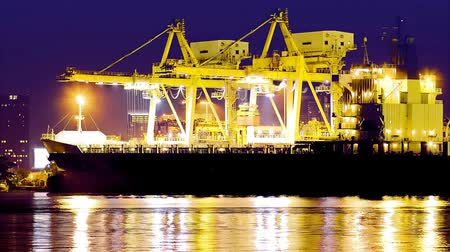 экономика : Industrial Container Cargo freight ship with working crane bridge in shipyard at dusk for Logistic Import Export