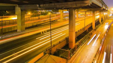 converge : Traffic in city at night with car speed. Stock Footage