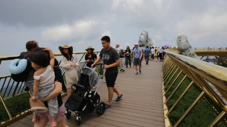 ba : Danang, Vietnam: 8 May 2019 -  The Golden Bridge with two giant hands in the Ba Na Hill Danang, Vietnam