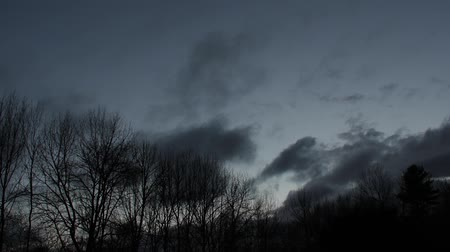 Time lapse of clouds moving and sky getting dark.