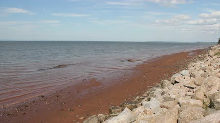 Muddy beach water of Evangeline Beach, Nova Scotia.