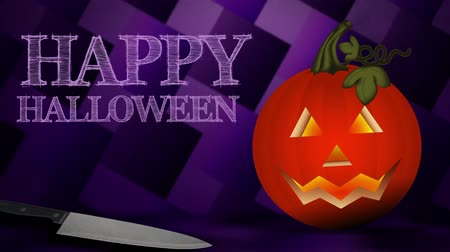 A jack-o-lantern rocks back and forth with a light flickering inside. Happy Halloween appears. Wideo