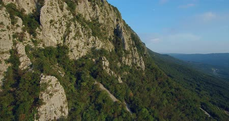 slovinsko : aerial footage of Mountain Nanos above Vipava valley covered with forest