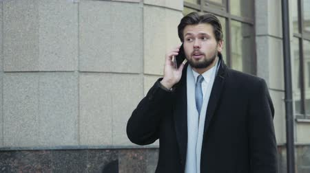 идущий : handsome businessman finished a phone call in downtown