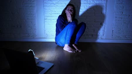 хулиган : Sad and scared female Young woman with computer laptop suffering cyberbullying and harassment being online abused by stalker or gossip feeling desperate and humiliated in cyber bullying concept. Стоковые видеозаписи