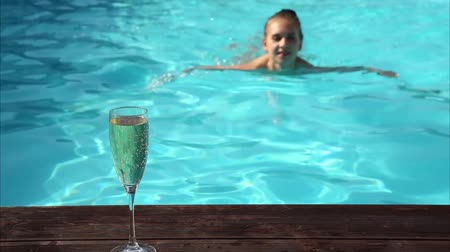 champagne pool : young happy woman drinks champagne in a swimming pool Stock Footage