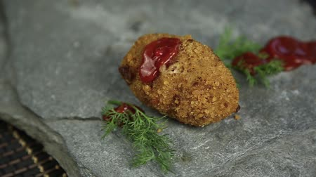 veal recipe : Homemade meat cutlets with parsley on stone, poured over food ketchup