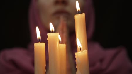 psicodélico : woman doing the magic ritual. close-up several candle. halloween or religion concept