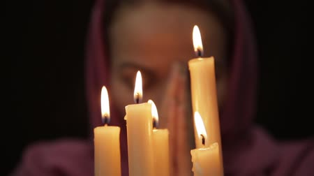 palmist : woman doing the magic ritual. close-up several candle. halloween or religion concept