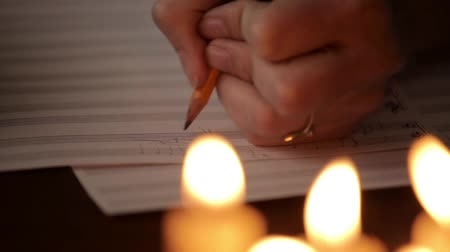 notation : student writing a music: musician composing with a pencil in a music book. musical staff Stock Footage