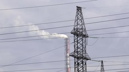 refining : Air pollution from industrial plants. Pipes throwing smoke in the sky Stock Footage