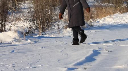 fur boots : walking in the snow Stock Footage