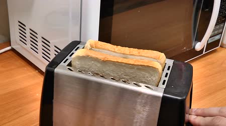 heating up metal : Make toast in the toaster Stock Footage