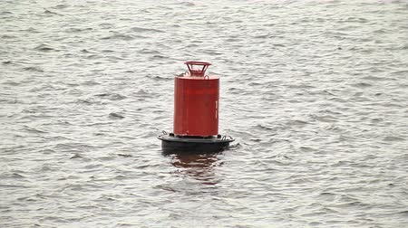 bóia : Red buoy sways on the water Vídeos