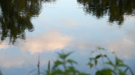 The reflection of the sky on the water surface Stock Footage