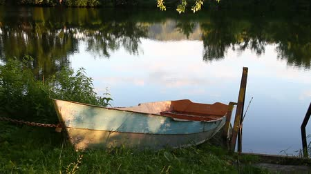 Boat standing on the shore of the lake