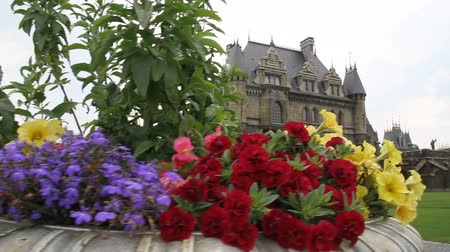 Panorama with beds of flowers in the ancient castle Stock Footage