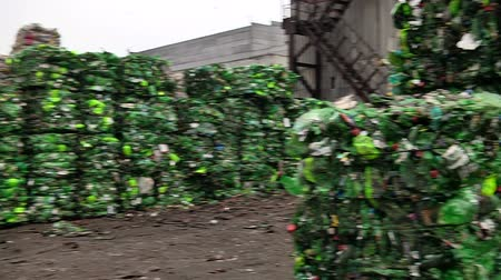 Piles of compressed plastic bottles prepared for recycling