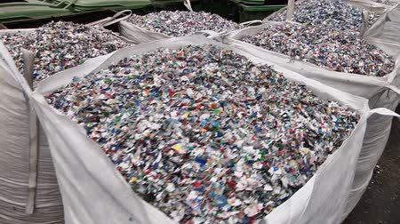 Crushed plastic bottles in the bag prepared for recycling Stock Footage