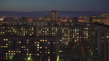 blokkok : Timelaps on the cityscape, view of the night houses with fading lights