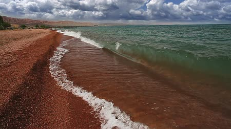 kumlu : Bright terracotta sand and clear water