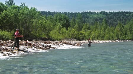 waders : Casting fly fishing at a mountain river