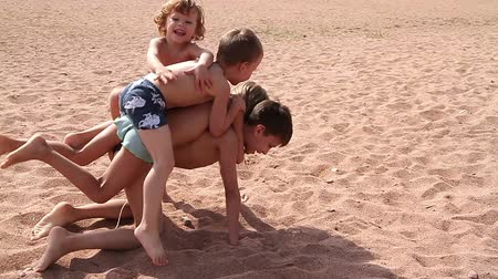 adorable : Children one by one climb on each other. Smallest - top