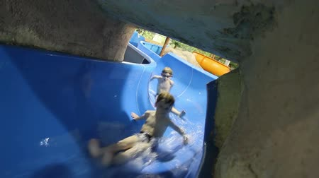 slayt : Children have fun and ride on the water slide at  waterpark