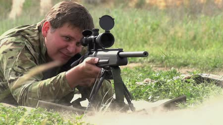 orvlövész : Sniper rifle shot does in the supine position. Slow Motion at a rate of 240 fps