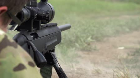 стрельба : Sniper rifle shot does in the supine position. Slow Motion at a rate of 240 fps