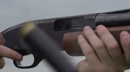 av : Empty case with gunpowder smoke emitted from a hunting rifle. Slow Motion at a rate of 240 fps Stok Video