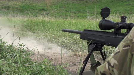 стрельба : Sniper rifle shot does in the supine position. Slow Motion at a rate of 240 fps  Стоковые видеозаписи