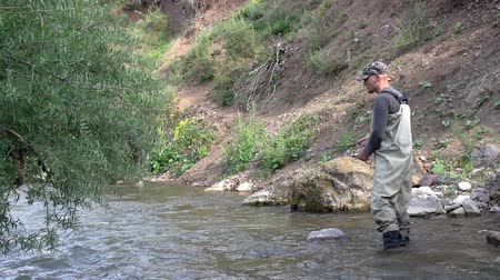 waders : Fisherman makes casting spinners downstream