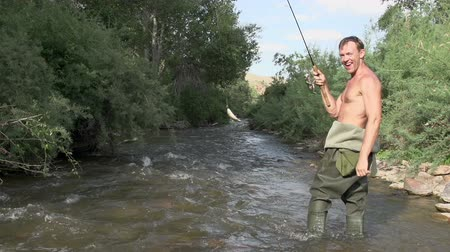 waders : Fish out of water trying to get off the hook. Slow Motion at a rate of 240 fps