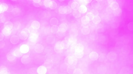 pink : Shining particles move randomly on a light pink background