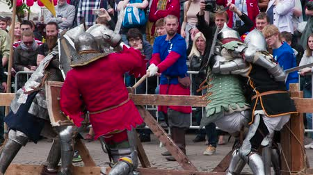 St. Petersburg, Russia. Spectators Enjoy Knightly Battles. Reconstruction of the traditional knight tournament. Warriors in medieval armor. Filmed at a speed of 240fps Stock mozgókép