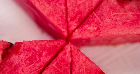 Slice of Watermelon Popularity. Triangular pieces of watermelon in turn disappear from the screen on a white background